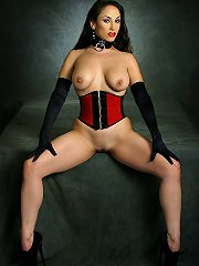 Brunette in corset gagged, strapped and suspended