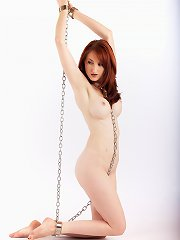Amazing babe consents to be bound in tight metal..