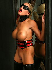 Massive breast Lady  in latex boots blindfolded ..